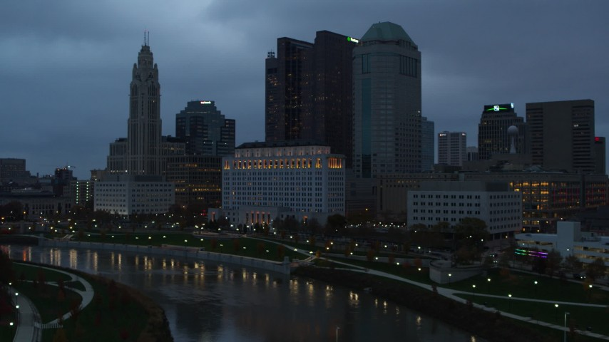 5.7K aerial video of the city skyline and the Scioto River at sunset, Downtown Columbus, Ohio Aerial Stock Footage | DX0001_002760