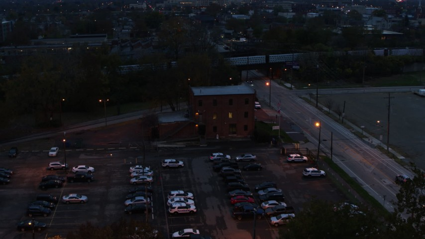 5.7K aerial video of orbiting a brick police station at twilight in Columbus, Ohio Aerial Stock Footage | DX0001_002761
