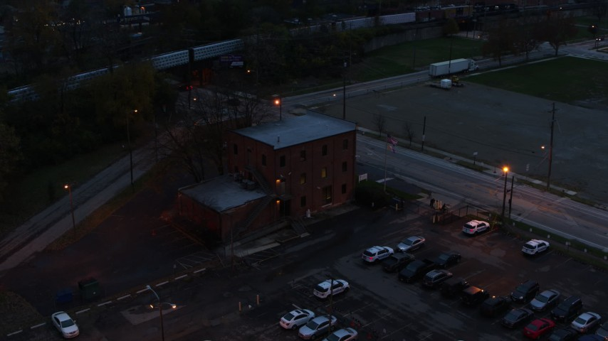5.7K aerial video of an orbit of a brick police station at twilight in Columbus, Ohio Aerial Stock Footage | DX0001_002762