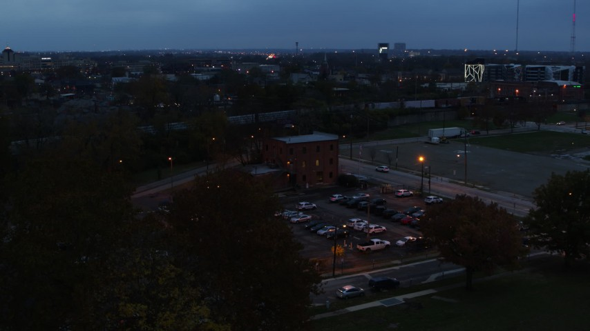 5.7K aerial video of approaching a brick police station at twilight in Columbus, Ohio Aerial Stock Footage DX0001_002764