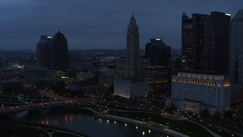 5.7K stock footage aerial video of LeVeque Tower across the river at twilight, Downtown Columbus, Ohio Aerial Stock Footage | DX0001_002772