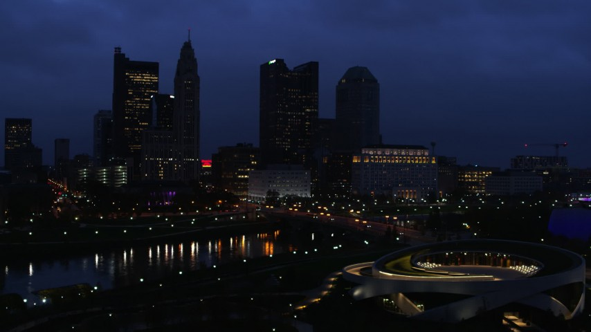 5.7K stock footage aerial video of the city skyline across the bridge and river at twilight during ascent, Downtown Columbus, Ohio Aerial Stock Footage | DX0001_002777