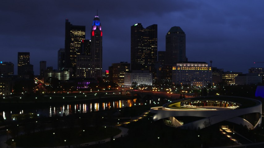5.7K aerial video of the city's skyline across the river at twilight during ascent in Downtown Columbus, Ohio Aerial Stock Footage | DX0001_002784