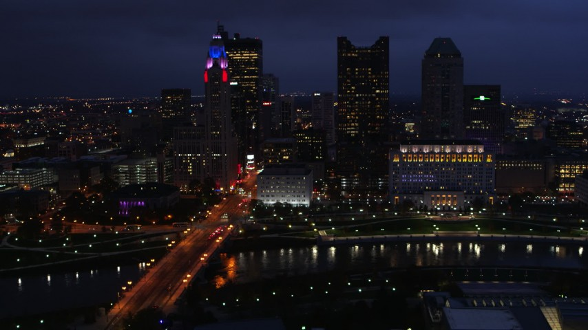 5.7K stock footage aerial video of the city's skyline across a bridge and river at twilight, Downtown Columbus, Ohio Aerial Stock Footage | DX0001_002785