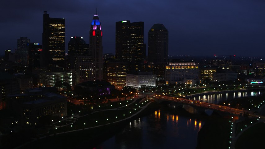 5.7K stock footage aerial video of  the city's skyline beside a bridge and river at twilight, Downtown Columbus, Ohio Aerial Stock Footage | DX0001_002788