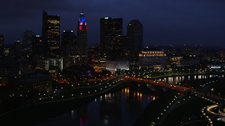 5.7K stock footage aerial video of the city's skyline and a bridge spanning the river at twilight, Downtown Columbus, Ohio Aerial Stock Footage | DX0001_002789