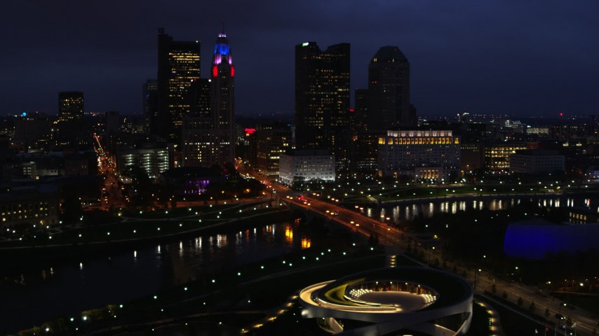 5.7K stock footage aerial video of a bridge spanning the river and city skyline at twilight, Downtown Columbus, Ohio Aerial Stock Footage | DX0001_002790