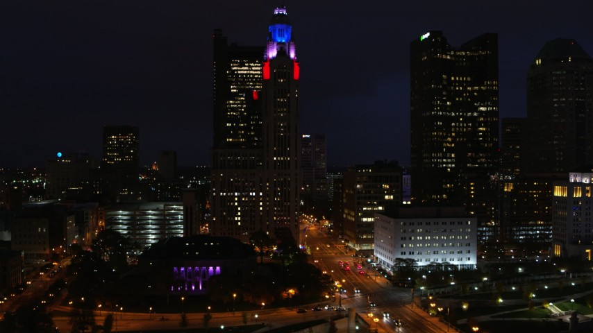 5.7K aerial video of flying away from LeVeque Tower at night, Downtown Columbus, Ohio Aerial Stock Footage | DX0001_002796