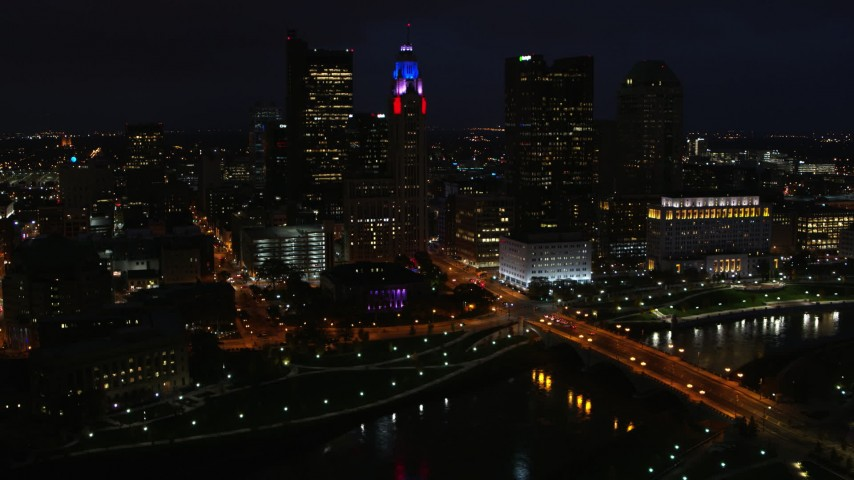 5.7K aerial video of flying by LeVeque Tower and city skyline at night, Downtown Columbus, Ohio Aerial Stock Footage | DX0001_002797