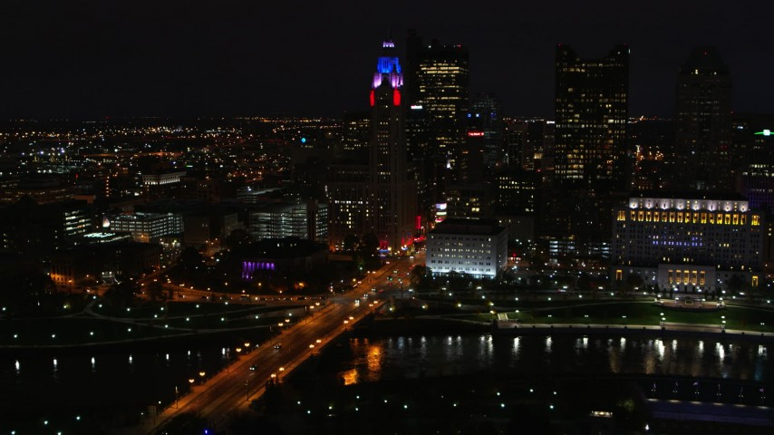 5.7K stock footage aerial video of LeVeque Tower and bridge spanning the river at night, Downtown Columbus, Ohio Aerial Stock Footage | DX0001_002800