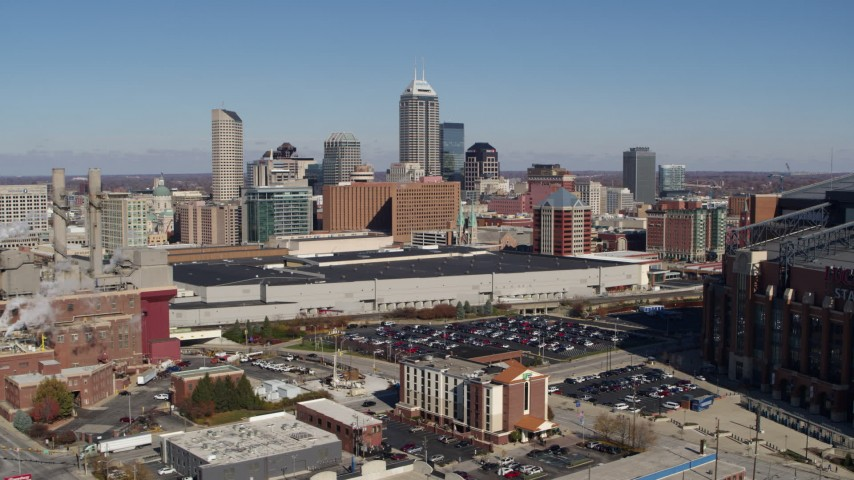 5.7K stock footage aerial video flyby brick factory and convention center, focus on city skyline, Downtown Indianapolis, Indiana Aerial Stock Footage | DX0001_002806