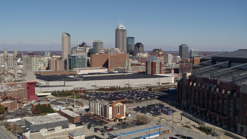 5.7K aerial video reverse view of skyline behind convention center, reveal brick factory, Downtown Indianapolis, Indiana Aerial Stock Footage | DX0001_002807