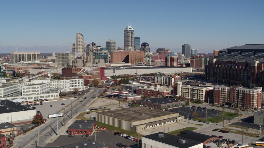 5.7K aerial video of the city skyline behind convention center during descent, Downtown Indianapolis, Indiana Aerial Stock Footage | DX0001_002808