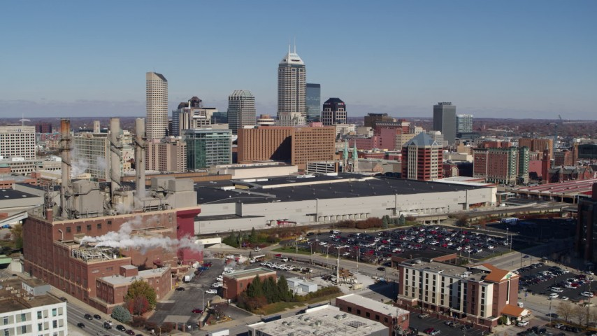 5.7K stock footage aerial video reverse view of brick factory, convention center and city skyline, Downtown Indianapolis, Indiana Aerial Stock Footage | DX0001_002810