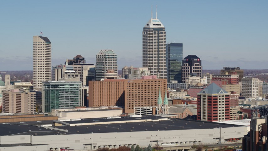5.7K stock footage aerial video of flying by the city's skyline in Downtown Indianapolis, Indiana Aerial Stock Footage | DX0001_002816