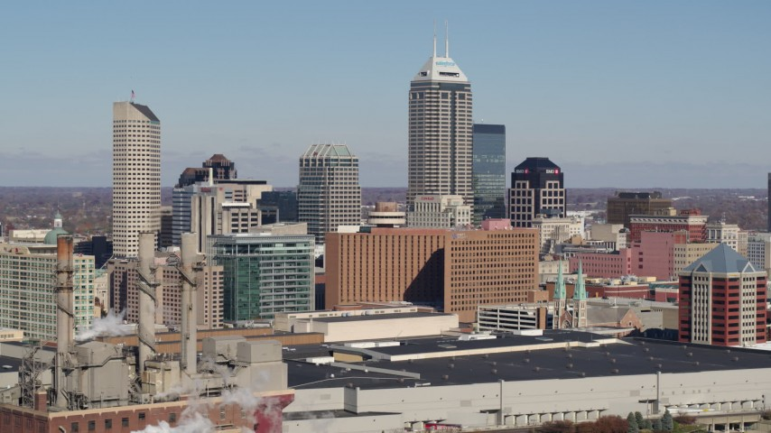 5.7K aerial video of the city's skyline seen from factory smoke stacks in Downtown Indianapolis, Indiana Aerial Stock Footage | DX0001_002818