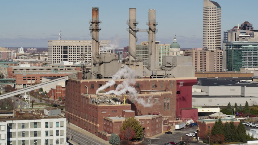 5.7K aerial video of passing by brick factory with smoke stacks in Indianapolis, Indiana Aerial Stock Footage | DX0001_002821