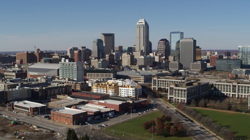 5.7K aerial video of ascending for a view of the city's skyline in Downtown Indianapolis, Indiana Aerial Stock Footage DX0001_002837