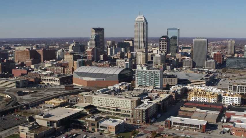 5.7K aerial video of flying away from arena and the city's skyline in Downtown Indianapolis, Indiana Aerial Stock Footage | DX0001_002840