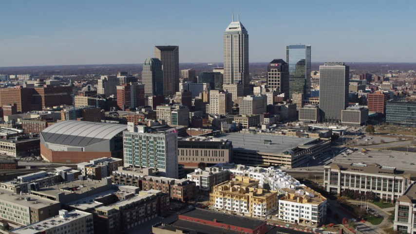 5.7K stock footage aerial video of flying by the city's skyline in Downtown Indianapolis, Indiana Aerial Stock Footage | DX0001_002842