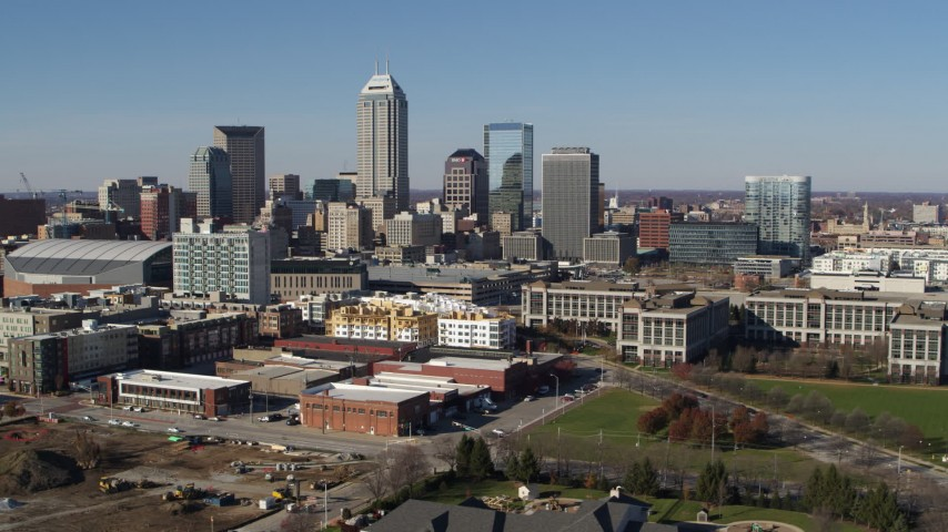 5.7K stock footage aerial video passing by the city's skyline in Downtown Indianapolis, Indiana Aerial Stock Footage | DX0001_002846