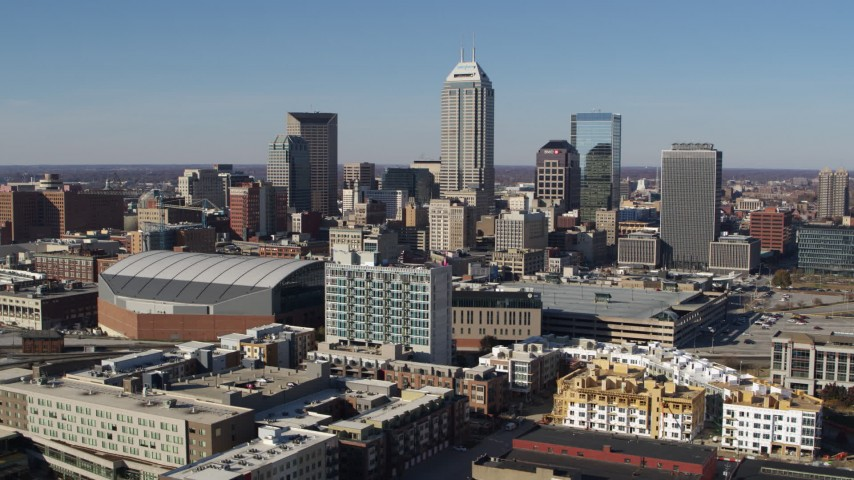 5.7K stock footage aerial video flying by the city's skyline near the arena in Downtown Indianapolis, Indiana Aerial Stock Footage | DX0001_002849
