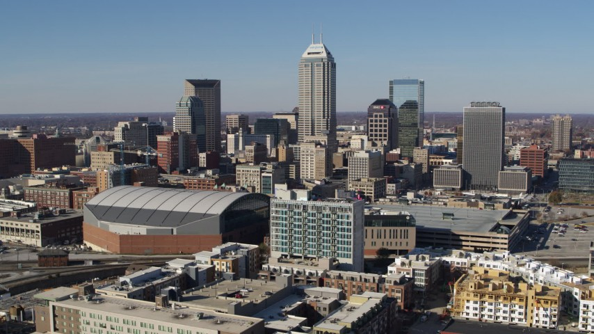 5.7K stock footage aerial video passing by the city's skyline near the arena in Downtown Indianapolis, Indiana Aerial Stock Footage | DX0001_002850