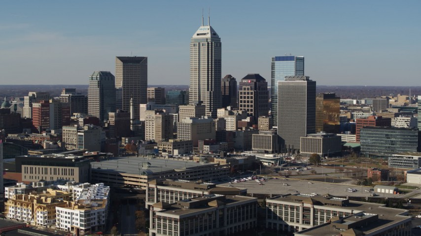 5.7K aerial video of a reverse view of tall skyscrapers in the city's skyline in Downtown Indianapolis, Indiana Aerial Stock Footage DX0001_002857