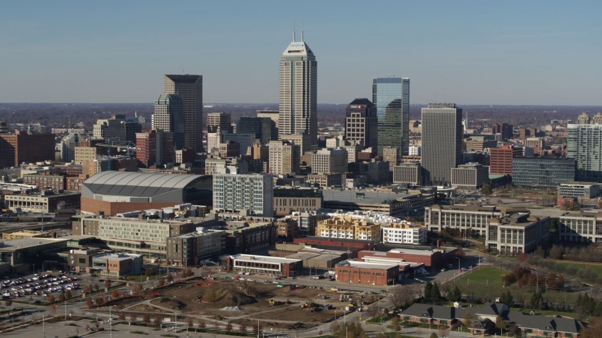 5.7K stock footage aerial video of passing by tall skyscrapers in the city's skyline in Downtown Indianapolis, Indiana Aerial Stock Footage | DX0001_002858