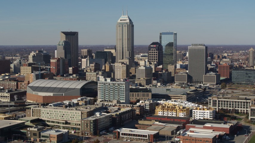 5.7K aerial video of slowly approaching tall skyscrapers in the city's skyline in Downtown Indianapolis, Indiana Aerial Stock Footage | DX0001_002859