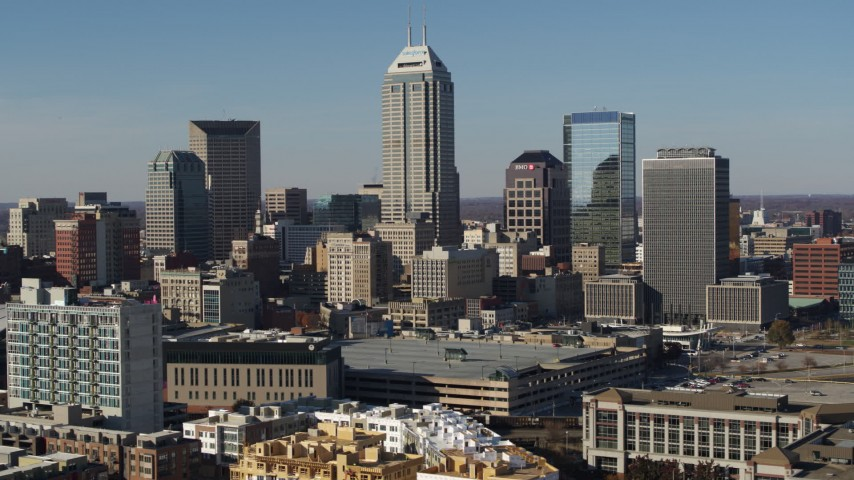 5.7K aerial video of slow flyby of tall skyscrapers in the city's skyline in Downtown Indianapolis, Indiana Aerial Stock Footage DX0001_002861