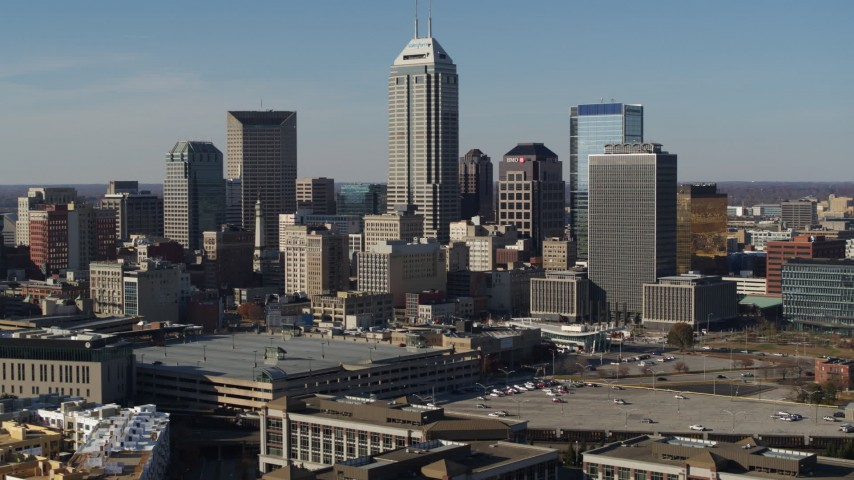 5.7K aerial video of slow reverse view of towering skyscrapers in the city's skyline in Downtown Indianapolis, Indiana Aerial Stock Footage | DX0001_002863
