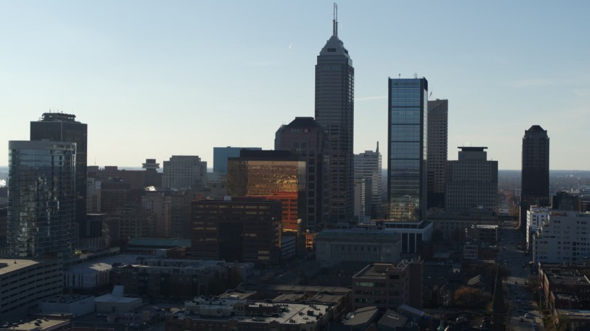 5.7K stock footage aerial video ascend while flying by the towering skyscrapers in the city's skyline in Downtown Indianapolis, Indiana Aerial Stock Footage | DX0001_002868