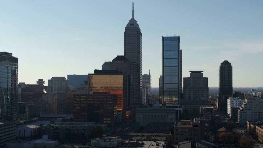 5.7K stock footage aerial video descend and flyby the towering skyscrapers in the city's skyline in Downtown Indianapolis, Indiana Aerial Stock Footage | DX0001_002869