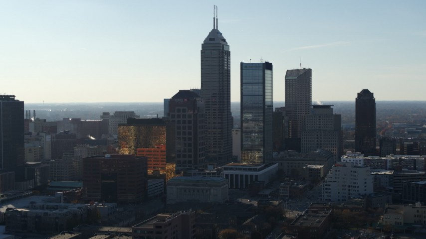 5.7K stock footage aerial video slowly passing by the towering skyscrapers in the city's skyline in Downtown Indianapolis, Indiana Aerial Stock Footage | DX0001_002871