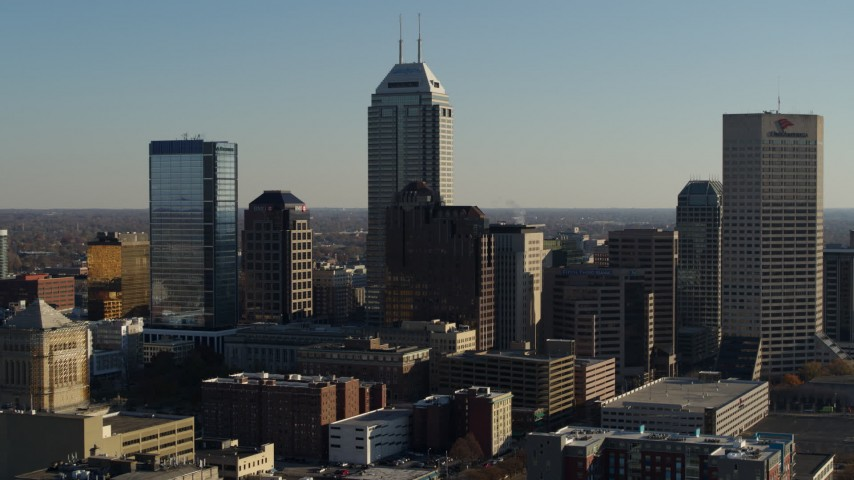 5.7K aerial video reverse view of Salesforce Tower skyscraper and skyline of Downtown Indianapolis, Indiana Aerial Stock Footage DX0001_002877
