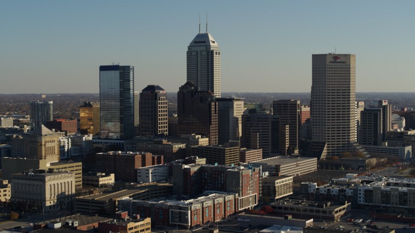 5.7K stock footage aerial video of flying by the skyline of Downtown Indianapolis, Indiana Aerial Stock Footage | DX0001_002878