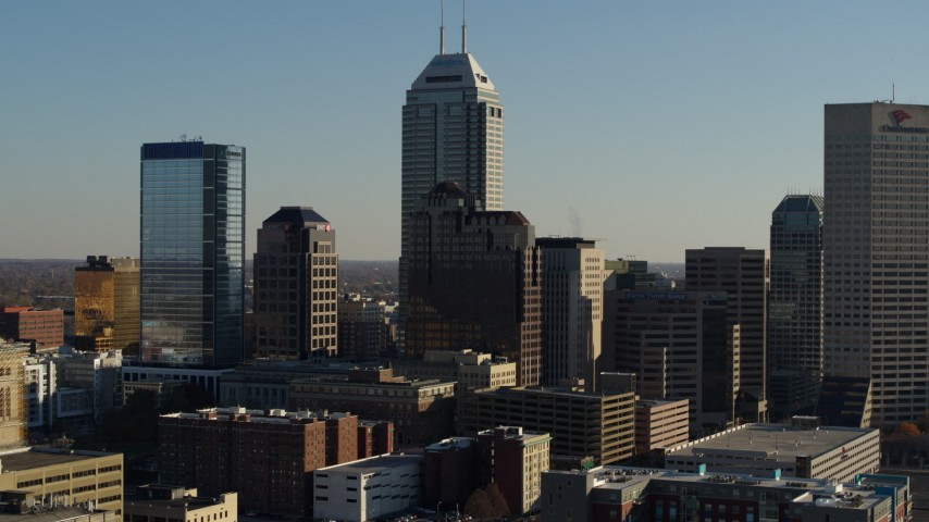 5.7K stock footage aerial video of flying by Salesforce Tower and the skyline of Downtown Indianapolis, Indiana Aerial Stock Footage | DX0001_002880