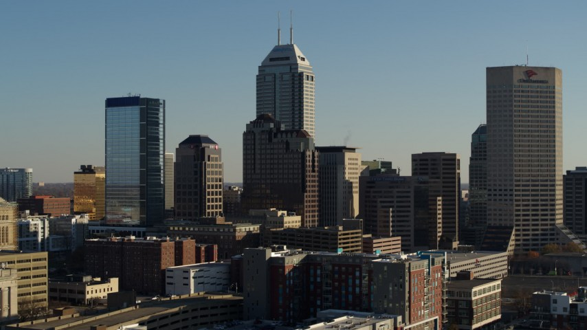 5.7K aerial video of flying away from Salesforce Tower and the skyline of Downtown Indianapolis, Indiana Aerial Stock Footage DX0001_002881