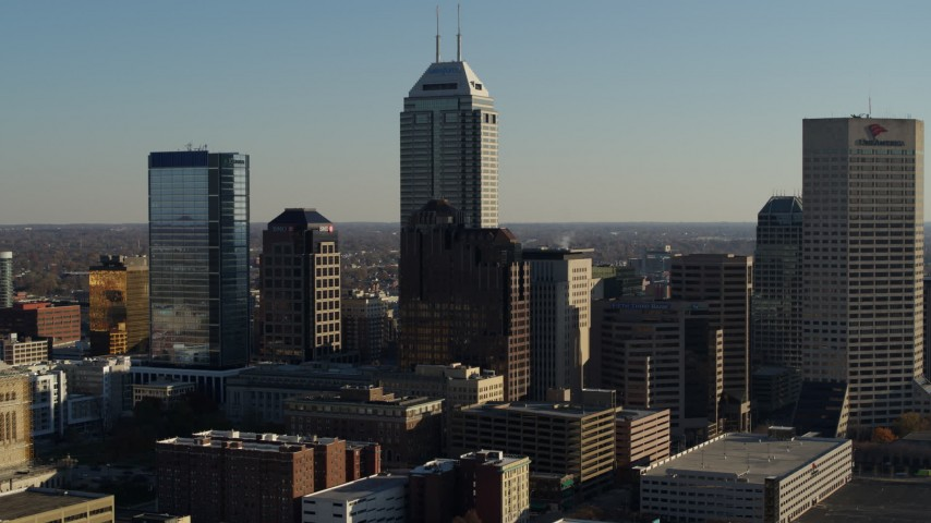 5.7K aerial video flyby skyscrapers in the skyline of Downtown Indianapolis, Indiana before ascent and approach Aerial Stock Footage | DX0001_002884