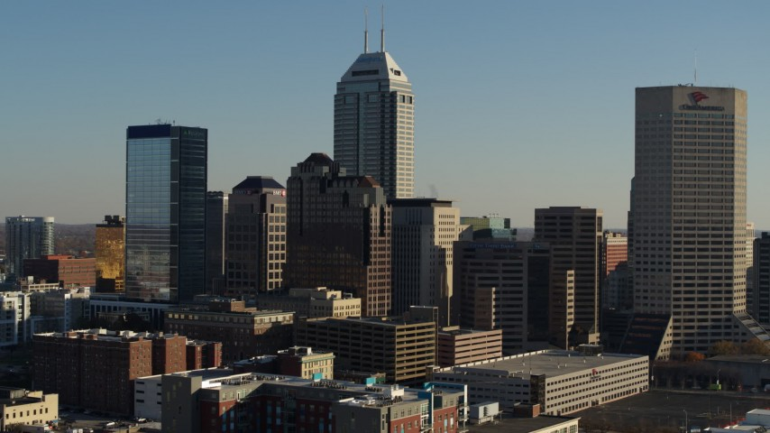 5.7K stock footage aerial video descend with reverse view of the skyline of Downtown Indianapolis, Indiana Aerial Stock Footage | DX0001_002885
