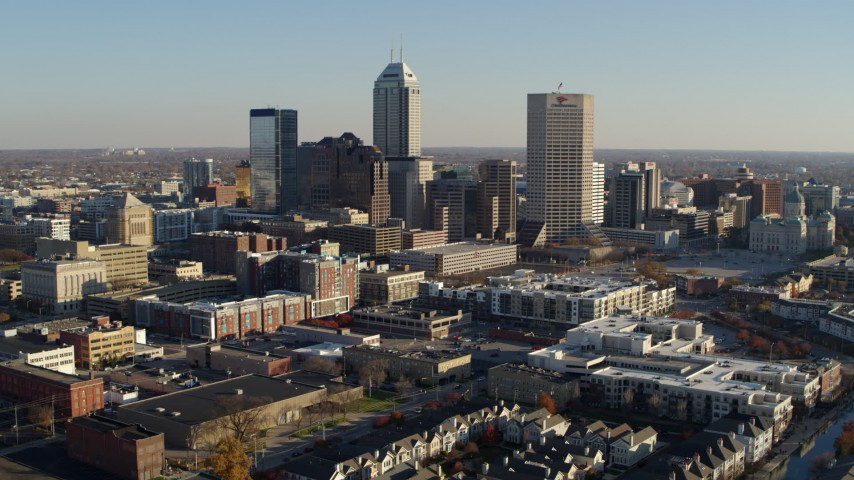 5.7K aerial video of a reverse view of skyline in Downtown Indianapolis, Indiana Aerial Stock Footage | DX0001_002891