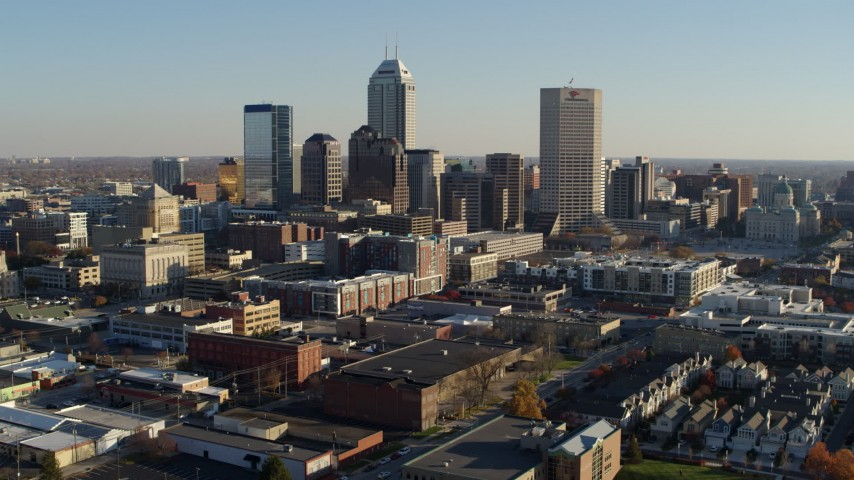5.7K aerial video of flying by the skyline in Downtown Indianapolis, Indiana Aerial Stock Footage | DX0001_002892
