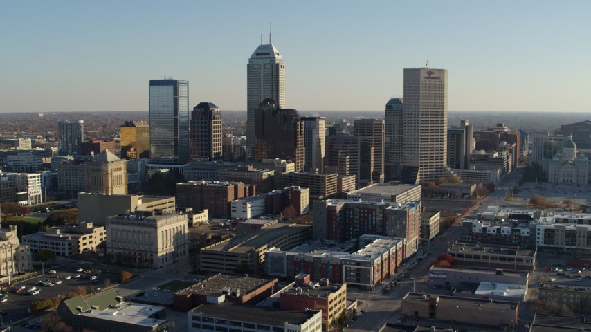 5.7K aerial video flyby the skyline in Downtown Indianapolis, Indiana and ascend Aerial Stock Footage | DX0001_002896