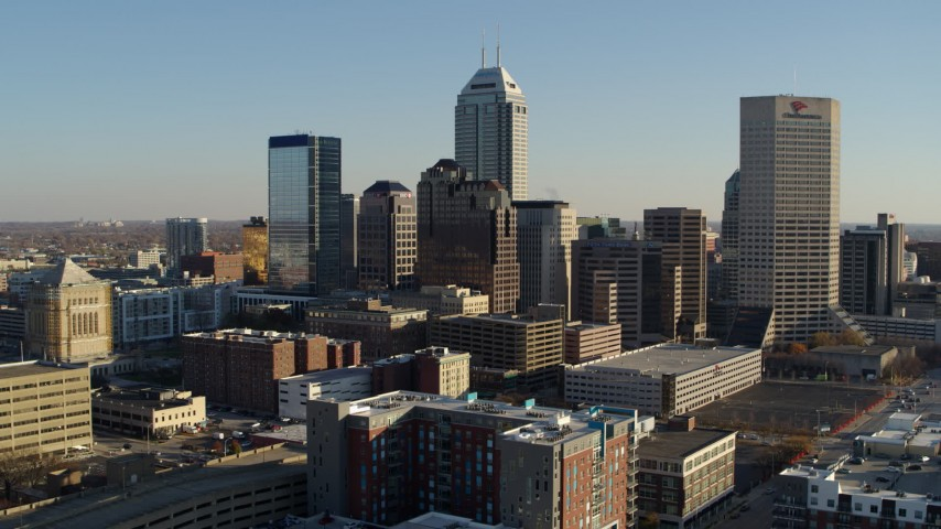 5.7K aerial video of flying toward the skyline's tall skyscrapers in Downtown Indianapolis, Indiana Aerial Stock Footage DX0001_002899