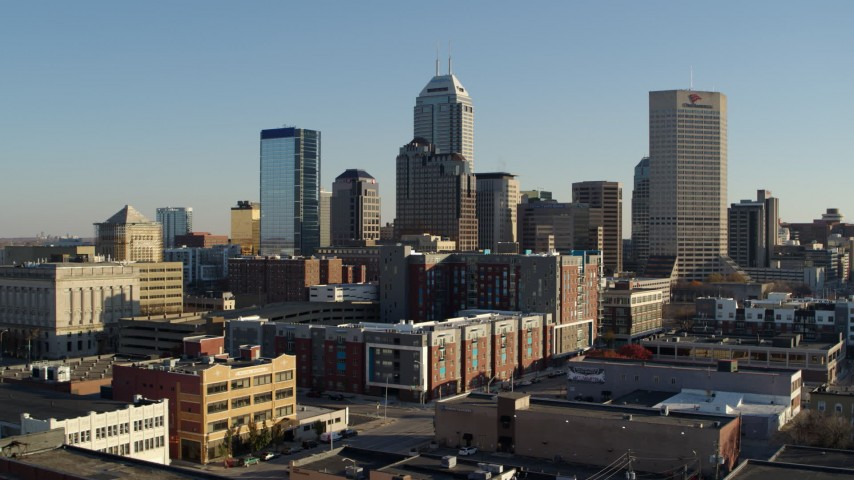 5.7K stock footage aerial video of flying from the skyline's tall skyscrapers in Downtown Indianapolis, Indiana Aerial Stock Footage | DX0001_002900