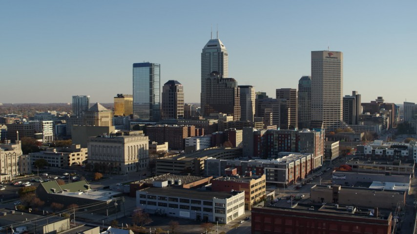 5.7K aerial video of flying from the skyline's tall skyscrapers and ascend in Downtown Indianapolis, Indiana Aerial Stock Footage | DX0001_002901