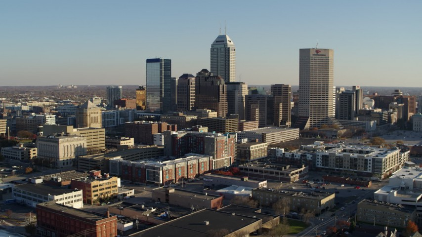 5.7K stock footage aerial video of approaching the skyline's towering skyscrapers in Downtown Indianapolis, Indiana Aerial Stock Footage | DX0001_002903