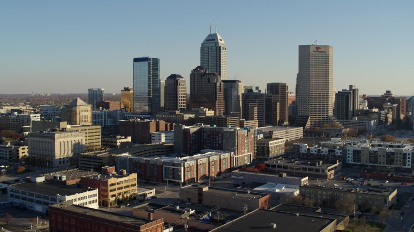 5.7K stock footage aerial video descend with view of the skyline's towering skyscrapers in Downtown Indianapolis, Indiana Aerial Stock Footage | DX0001_002904