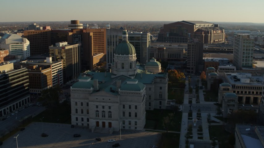 5.7K aerial video reverse view of the Indiana State House and ascend in Downtown Indianapolis, Indiana Aerial Stock Footage | DX0001_002910